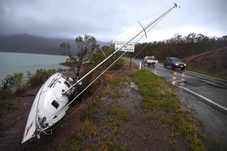 A yacht lies beside a road after Cyclone Debbie hit Airlie Beach. AAP/Dan Peled/via REUTERS