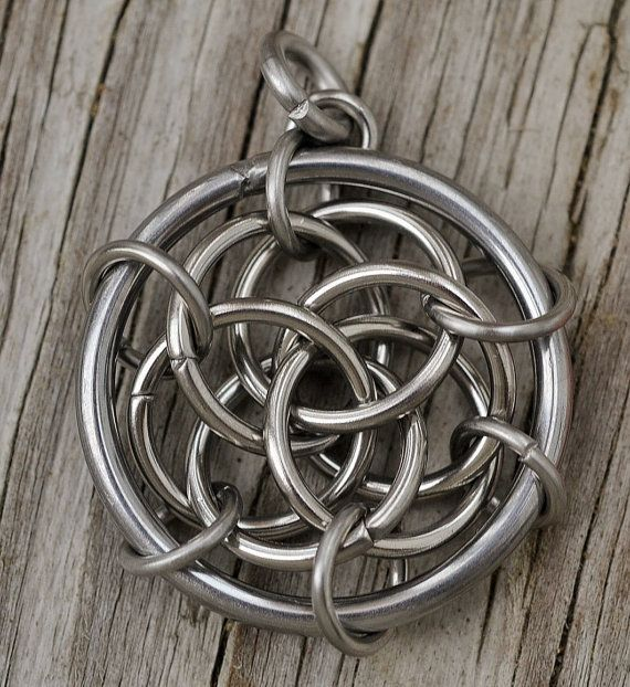 Check out this item in my Etsy shop https://www.etsy.com/listing/235398496/interwoven-triquetra-medium-chainmaille