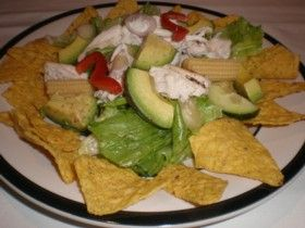 Crunchy Corn Chip Salad.   Very refreshing salad with corn chips.  For the recipe see: http://www.cheap-and-easy-recipes.com/individual-recipes/crunchy-cc-salad.php