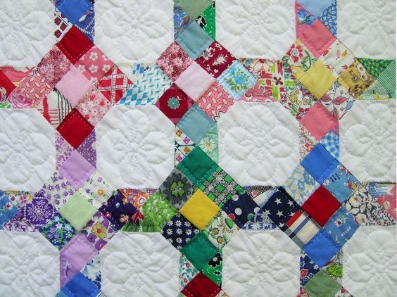 9 patch and snowball combined on point...good for lots of scraps. Love the quilting in the middle too.