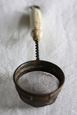 I use a strainer like this to dip ice out of horses buckets during the winter. No muss, no fuss.