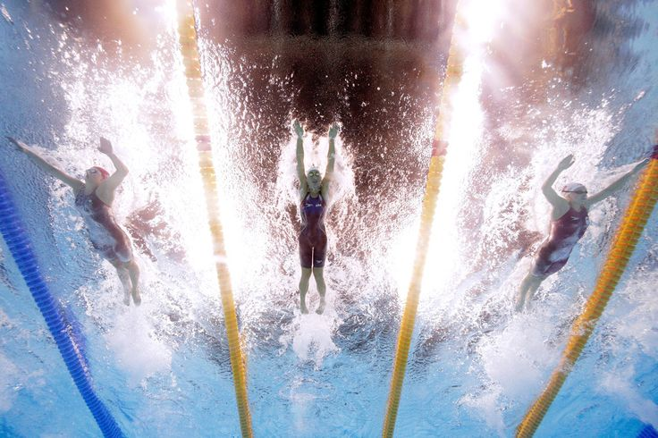 L-R) Aimee Willmott of Great Britain, Madeline Dirado of the United States and Emily Overholt of Canada compete in heat four of the Women's 400m Individual Medley on Day 1 of the Rio 2016 Olympic Games at the Olympic Aquatics Stadium on August 6, 2016 in Rio de Janeiro, Brazil. (Source: Al Bello/Getty Images South America)