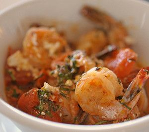 Oven baked shrimp with tomato and feta.This recipe belongs to Greek cuisine.You can use it as an appetizer or main dish.