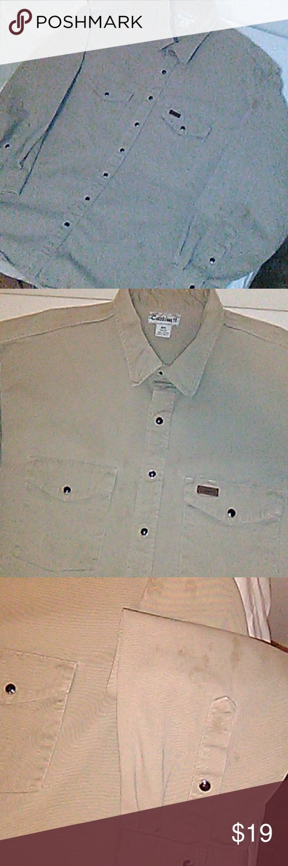 Carhartt work shirt This shirt is big, heavy, tough, prestained with oil, and has a light nick from the chainsaw. So unless you are or know a real man it ain't for you! In great shape really. Carhartt Shirts Casual Button Down Shirts