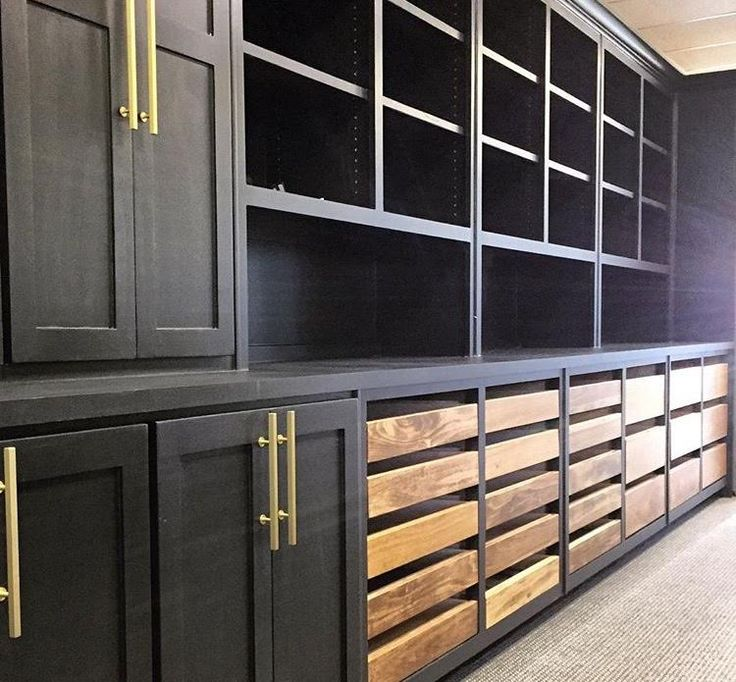 decided to paint the cabinets in our design office black and stain the materials drawers for a unique contrast about to fill up this space with fresh
