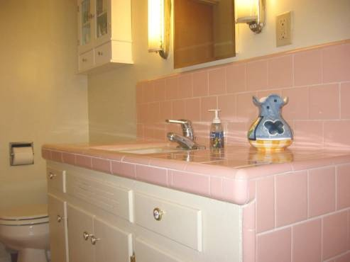 S Pink Tiled Bathroom Sink