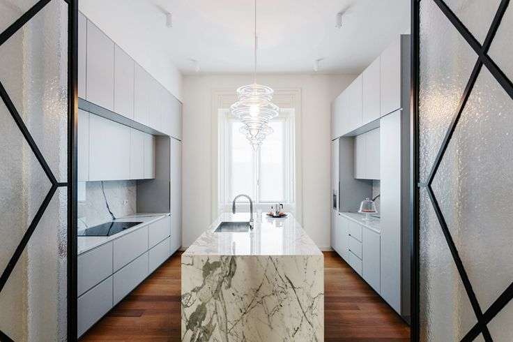 Located in a nice residential area in Milan, the apartment is part of an elegant and well designed 1920's complex.  #nomadearchitettura #design #interiors #interiordesign #italiandesign #italianstyle #luxury #milaninteriors #decor #marbles #glasslights #pendantlight #lightgrey #luxurylife #stools #kitchendesign #luxurykitchen #SimoneFuriosi