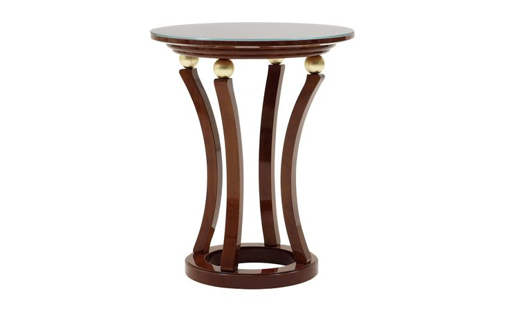 The side table Marco features four curved legs with a glass table top.