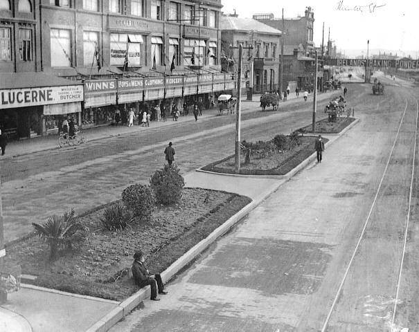 """HUNTER ST NEWCASTLE, 1910.  Notes from NCC Photobank page: """"Looking west is the Winns Building on left, tram line on right and top right is the A.A. Company's Bridge."""""""