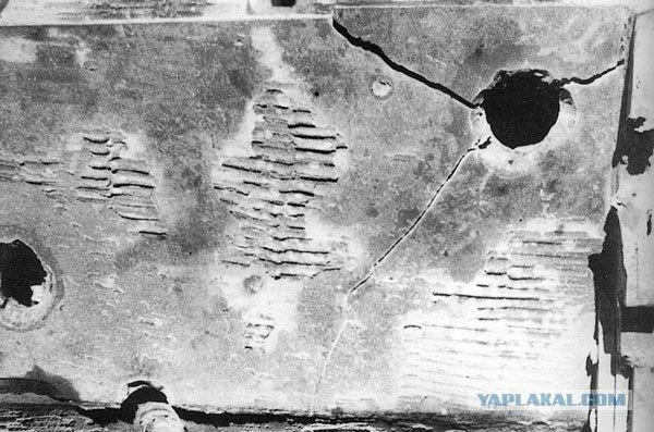 A great detail photo showing shell penetrations on the side of a Tiger 1 hull section with one causing a large crack from the impact and resulting explosion