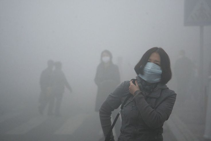 Girl walks through smog in Beijing, where small-particle pollution is 40 times over international safety standard - 42 Shocking Photos Showing Severe Pollution In China  Best of Web Shrine