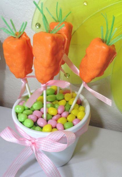 Easter Rice Krispie Treat carrots!  Super easy to make - I used the store -bought treats, shaped them into carrots and dipped into orange candy melts.  I added edible grass I found at Target on top.