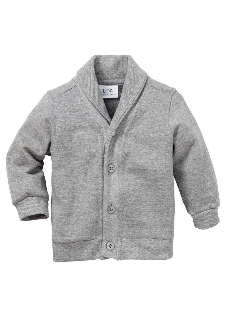 Mikinová bunda pro malé chlapečky. Se šálovým límcem a čtyřmi knoflíky vpředu. Žebrované lemy, k pokožce přívětivá organická bavlna. 100% Bavlna (organická)