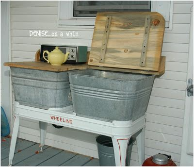 Double wash tub to hold cold drinks. From the Fabulous Farmhouse Tour: On the Back Porch