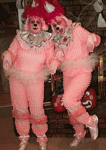 Pink Poodle costumes featuring thousands of pom pom balls won best pairs costumes in the contest