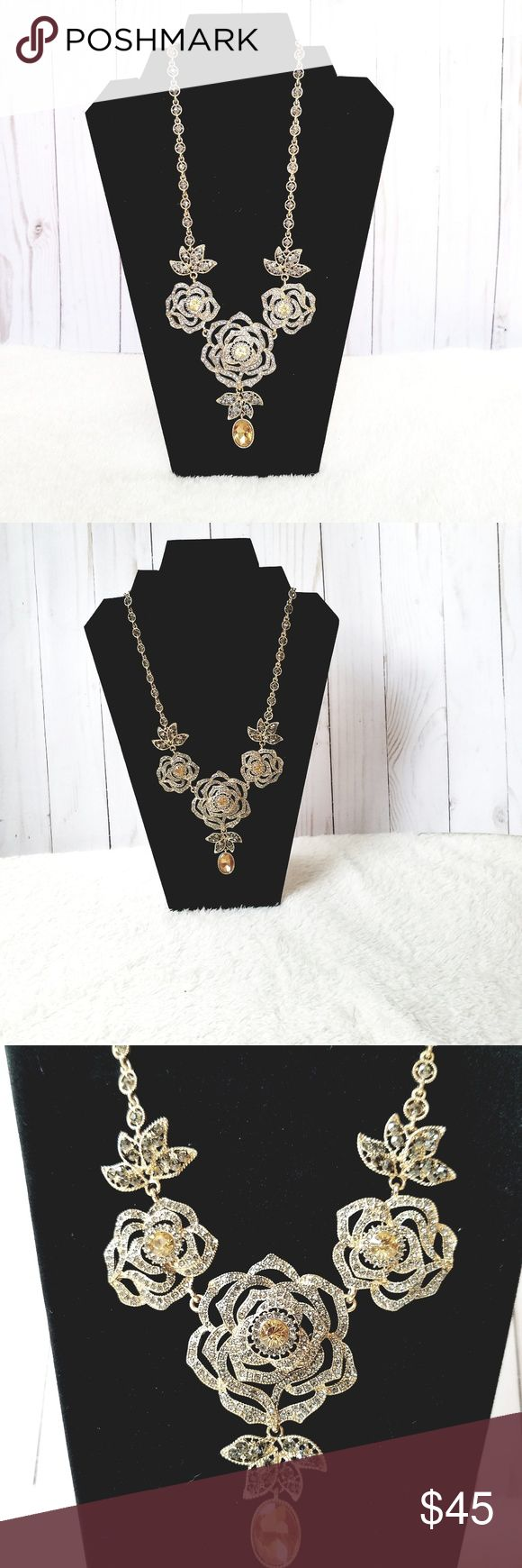 NATASHA ACCESORIES, GORGEOUS RHINESTONES NECKLACE Absolutely beautiful rhinestone necklace by Natasha. Features roses shaped in gold with 3 different color of  rhinestones, yellow, crystal and dark green. Perfect for graduation, wedding or any formal occasion. Total length: 13″.  Smoke and pet free. Offers always welcome!!! Acepto ofertas!!! ♡ BUNDLE & SAVE MORE ♡ Natasha Couture Jewelry Necklaces