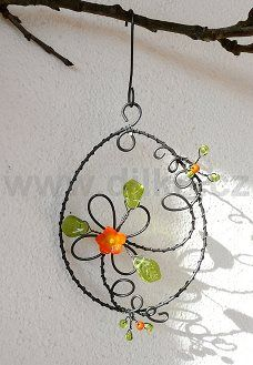 A few simple twists of wire and some glass beads and you have a pretty ornament for the window or to hang from your rear view mirror.