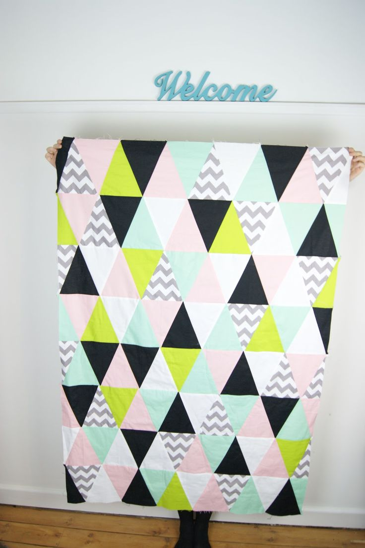 I have finished my triangle quilt top! I am really pleased with how it looks so far. Now I just need to splash out on some backing fabric a...