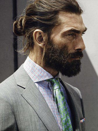 Man bun in a suit.