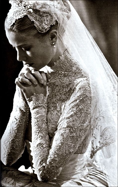 """Princess Grace Kelly during her legendary wedding to Rainier III, Prince of Monaco  Gown by: Helen Rose  """"The wedding dress consisted of a rounded collar, full skirt of ivory peau de soie, and a fitted bodice made from Brussels lace embroidered with seed pearls. The lace was over a century old and had flower designs in it. 25 yards of silk taffeta and 100 yards of silk net were used in the construction of the dress."""""""
