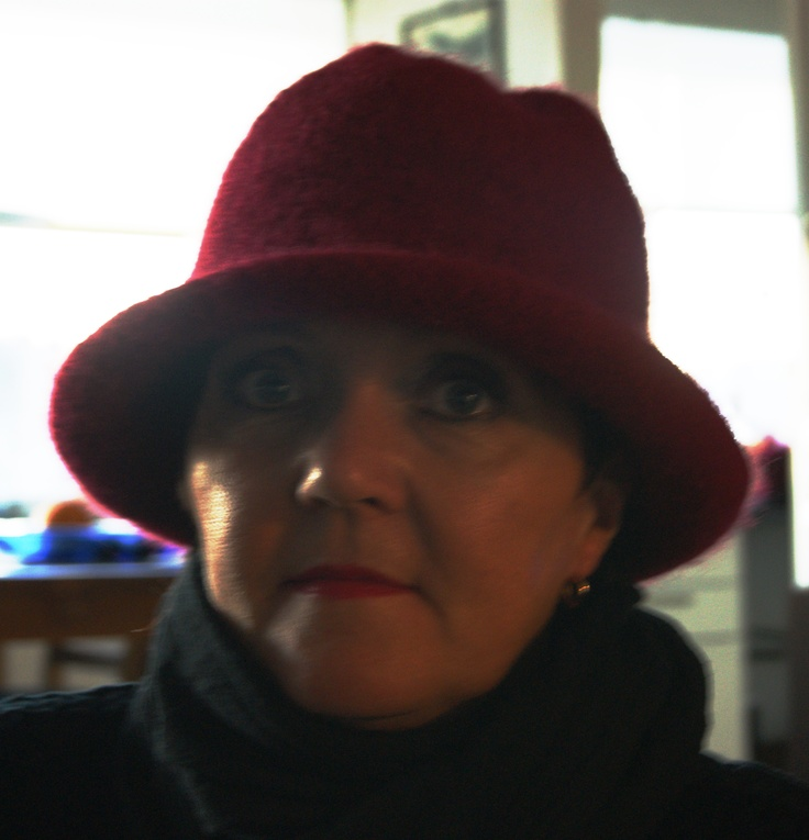 Red felted hat to brighten up the winter