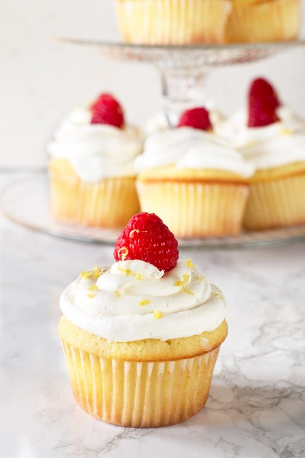 Lemon Raspberry-Filled Cupcakes with White Chocolate Buttercream Frosting from @cakenknife