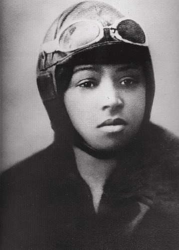"""""""Born in 1892, the beautiful, tough, determined and incredibly inspirational, professional aviator Bessie """"Queen Bess"""" Coleman was the first African American (in the world) to attain a pilot's license. At age 30, she was considered """"the world's greatest woman flyer."""" Her tragic death at only 34 ended a fierce and brilliant career."""""""