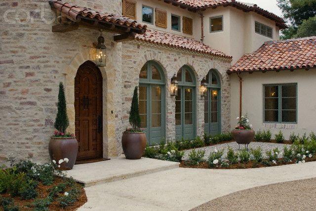 Spanish Style House; copper accents, tile roof, light brick, grey-green trim