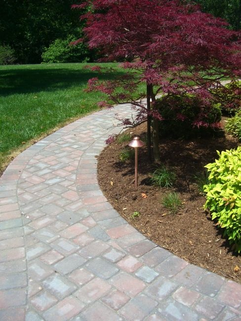 Finely Crafted Stone Walkway Wrapping Around Shrubbery #landscaping