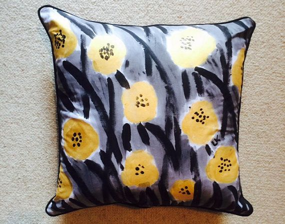 Black and metallic gold flowers in a field cushion by LouiseMKent