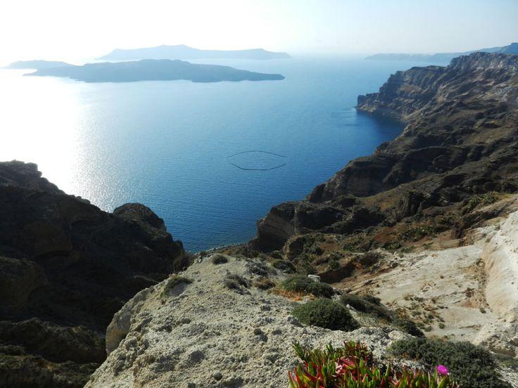 Santorini, Greece - a view to Caldera and Nea Kameni. #travel, #destination, #Santorini, #Greece http://travellingwizards.com/destinations/countries/greece/islands/santorini