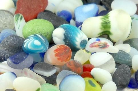 <p>Santa Cruz, California sea glass can only be collected on one beach in the world! Pictured are the true gems of my collection. They have been lovingly displayednon this all cotton, Ladies' V-neck T-shirt. Your choice of color.</p>