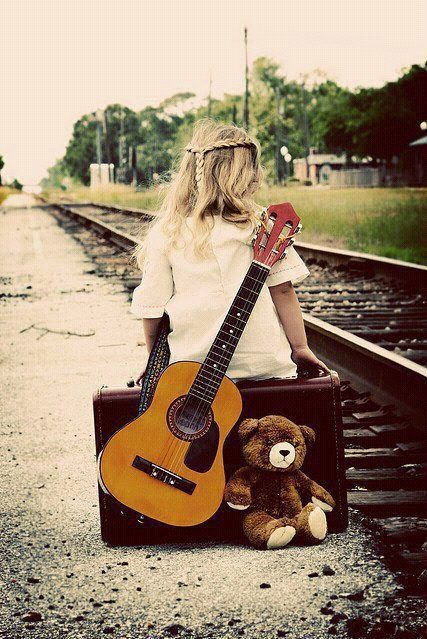 Even at a young age I knew music was my life. With my old acoustic guitar and my teddy bear in hand, I set off to start my career.---Not really wedding related, but it reminds me of you :)