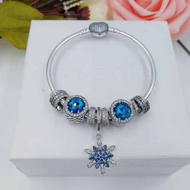 New in our store:pandora bangle br... check it out here!http://www.charmsilvers.com/products/pandora-bangle-bracelet-with-pave-heart-clasp-blue-snow-flake-theme?utm_campaign=social_autopilot&utm_source=pin&utm_medium=pin