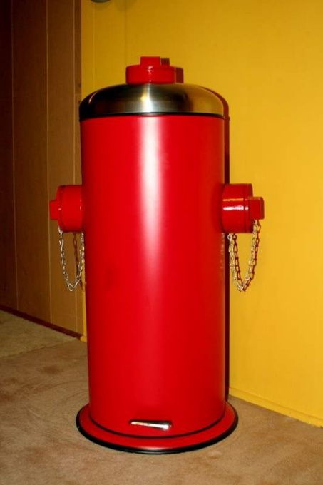 Plain metal bin made over into hydrant using PVC pipe.