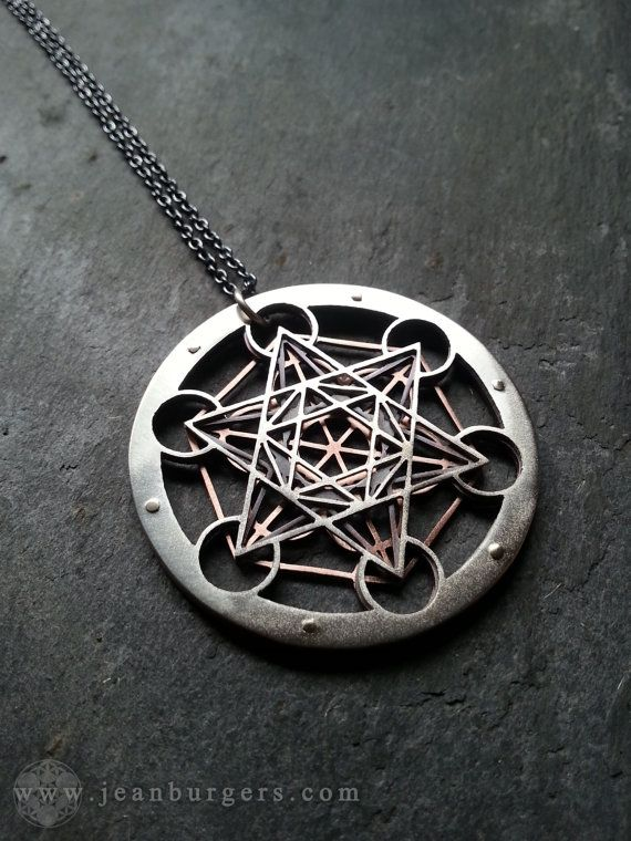 This pendant is one of a series of unique works I created depicting variations of the Metatrons Cube. It is one of the most complex designs that I make. I handcut three layers of sterling silver and oxidised copper so that when put together, they form the Metatrons Cube. I cut them by hand using a tiny sawblade, and riveted them together with 9ct gold rivets.  This pendant is 4.5cm in diameter, and comes on a 45cm oxidised sterling silver chain. Feel free to select a different chain length…