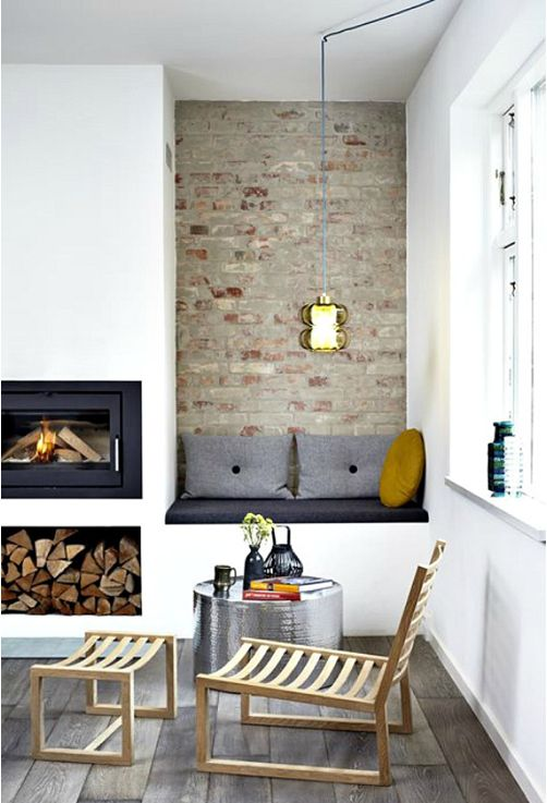 Texture of accent wall looks cool against smooth texture of surrounding walls