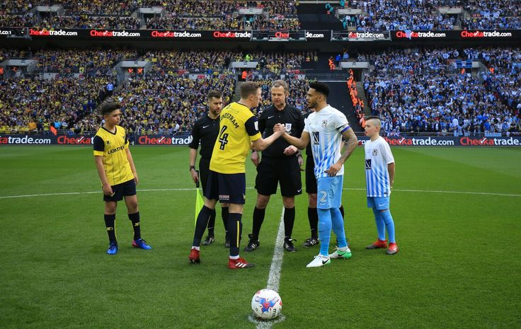 Coventry City 2 Oxford Utd 1 in May 2017 at Wembley. Captains, John Lundstram and Jordan Willis, meet before the FA Football League Trophy Final.