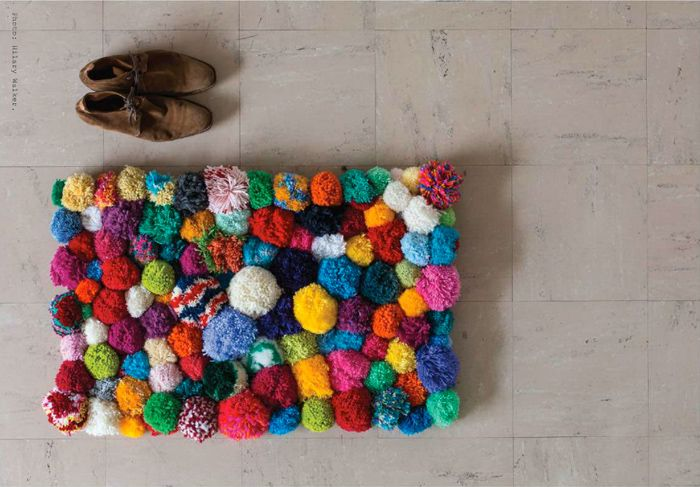 Pom Pom Rug. You can never have enough pom poms in my book.