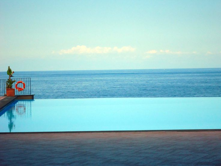 Enjoy yourselves by the #pool overlooking the amazing #Ionian #Sea at Santa Tecla Palace #Hotel in #Sicily. www.santateclapal... | #TraveltoSicily #Travel