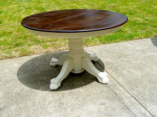 Painting the pedestal and apron of a round oak table ... Sand and restain top. Gorgeous!