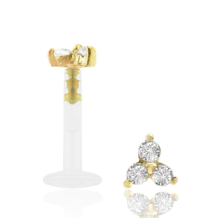 Bijou de piercing en bioplast avec trio d'oxyde de zirconium blanc griffé sur un clip en or jaune 18 carats.