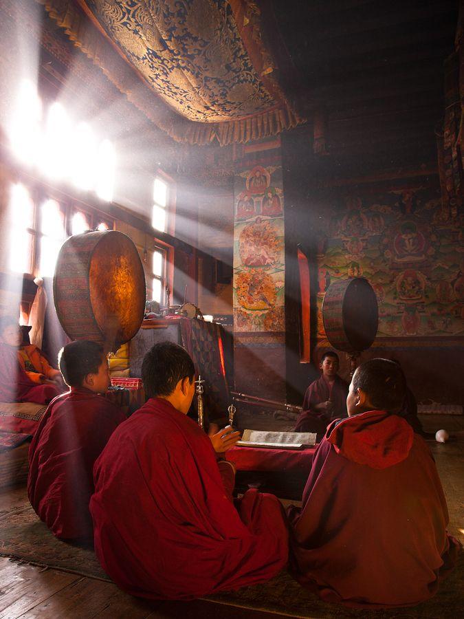 Tibetan monks... love the light in this photo