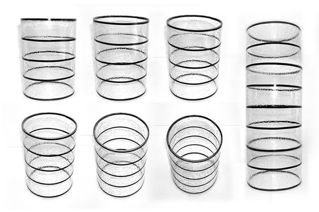 These are photographs of a glass with horizontal bands of tape around it (sourced from IDsketching). These photos provide a superb illustration of how ellipses – when viewed from any angle – are rounded (as opposed to pointed) at the ends.