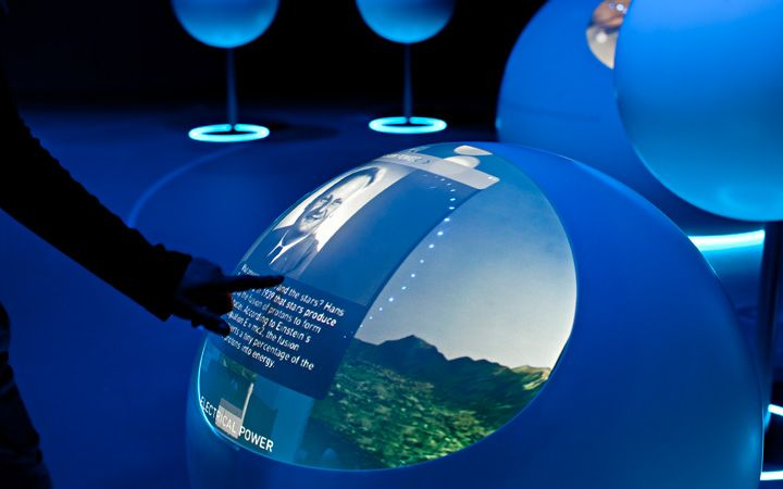 """Boson.  The permanent exhibition in the visitor centre Globe of Science and Innovation communicates the dimension and the fascination of the research work, which takes place at CERN. The visitor enters a """"Universe of Particles"""". Spherical exhibition units offer a variety of possibilities for information and interaction, target-group-specific and thematically prepared."""