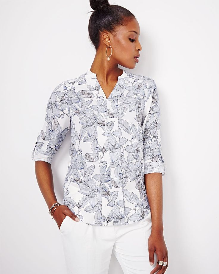 Refresh your wardrobe with this printed challis blouse featuring long rolled-up sleeves and half button placket.<br /><br />- Roll-up sleeves buttoned tab<br />- V-neck<br />- Small cuffs