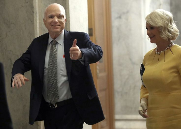 WASHINGTON, DC - JULY 25:  Sen. John McCain (L) (R-AZ) returns to the U.S. Senate accompanied by his wife Cindy (R) July 25, 2017 in Washington, DC. McCain was recently diagnosed with brain cancer but returned on the day the Senate is holding a key procedural vote on U.S. President Donald TrumpÕs effort to repeal and replace the Affordable Care Act..  (Photo by Win McNamee/Getty Images)