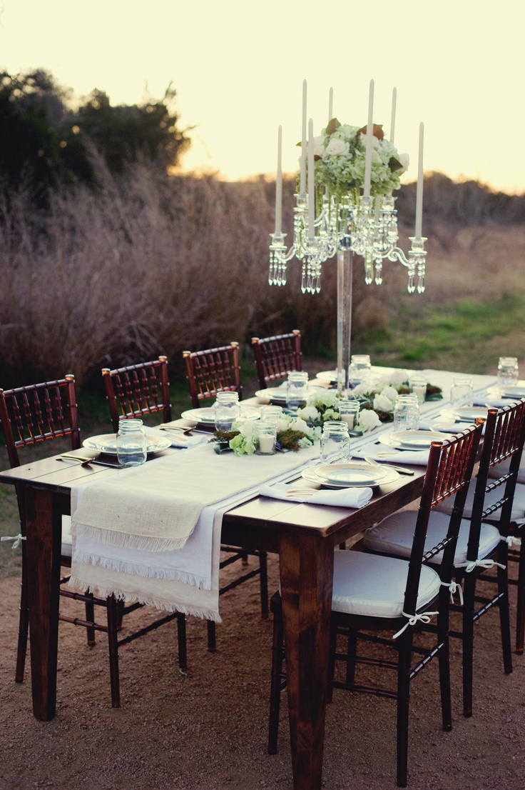 The tall centerpieces will be crystal candelabras with center sprays of white hydrangeas, pale pink peonies, mini mauve-purple cymbidium orchids, and pale pink roses.