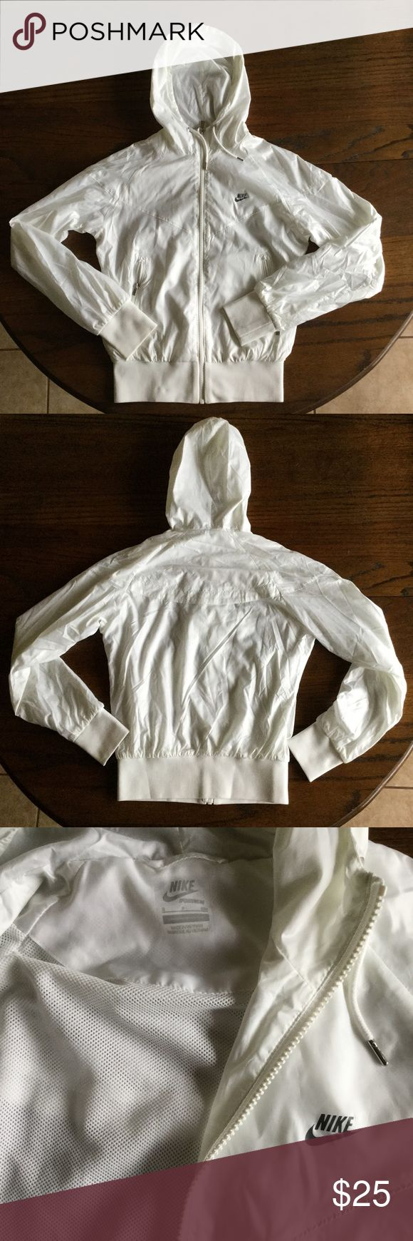 White Nike Windrunner Running jacket Good condition, lightly used, no stains rips or tears. All white Nike Jackets & Coats