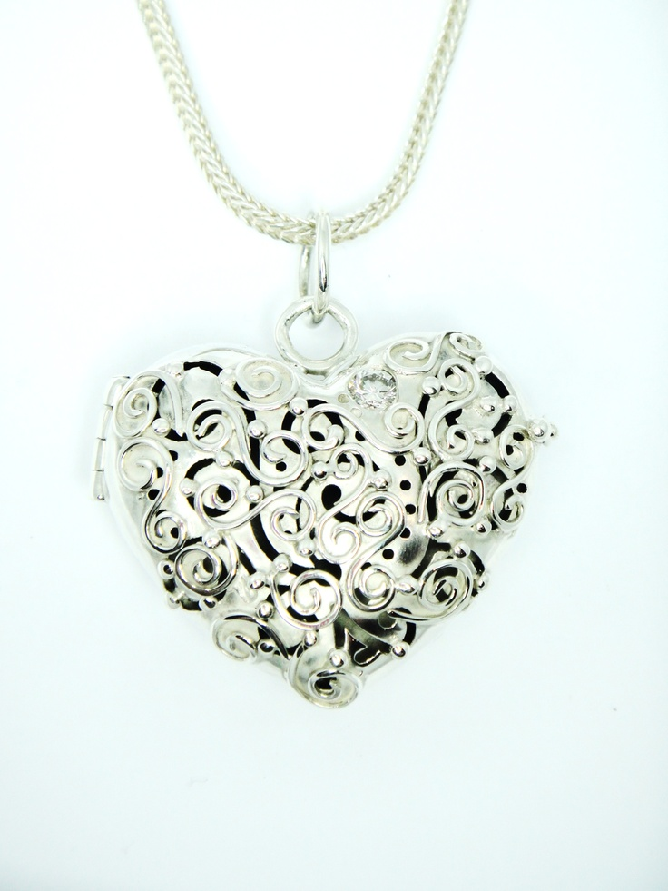 a Diamond set in the highly detailed Silver locket